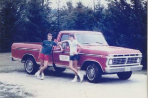 Marty and Rich by a red truck, 1984